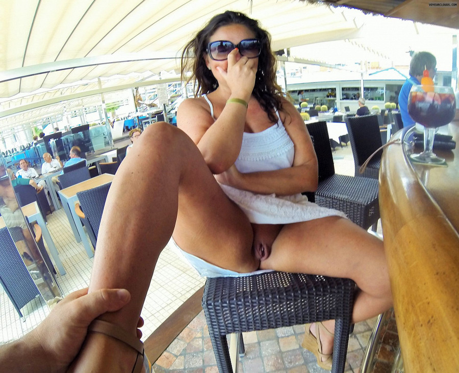 Hot ebony beauty nia baring her breasts and flashing naked pussy in public
